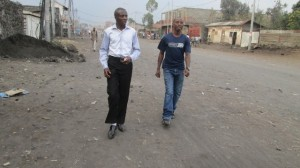 Joseph Munyambanza (right) walks with Baraka Emmanuel, COBURWAS country coordinator of the Democratic Republic of Congo.