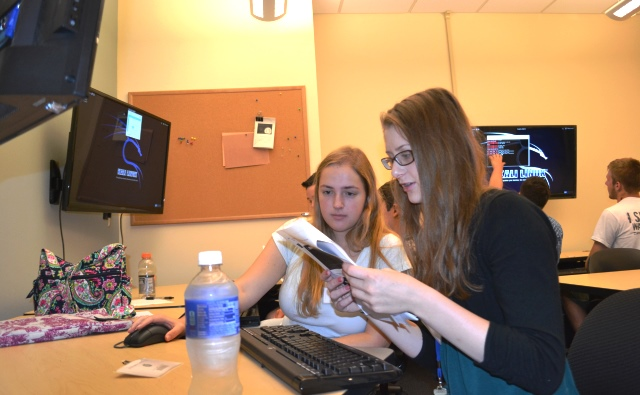 Students participate in a hands-on activity in Westminster's new cybersecurity labs.