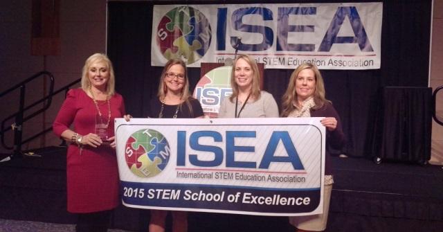 Andrea (center right) celebrates her program's award with her co-educators