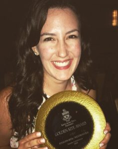 Courtney with award