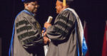Dr. Benett Omalu receives an honorary degree at Westminster College, presented by President Benjamin Akande. Sept. 15, 2016.